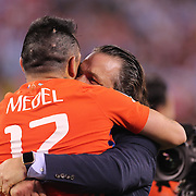 EAST RUTHERFORD, NEW JERSEY - JUNE 26: Chile national football team manager Juan Antonio Pizzi hugs Gary Medel #17 of Chile after their sides penalty shoot out victory during the Argentina Vs Chile Final match of the Copa America Centenario USA 2016 Tournament at MetLife Stadium on June 26, 2016 in East Rutherford, New Jersey. (Photo by Tim Clayton/Corbis via Getty Images)