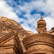 Muhammed, 14, who has grown up climing the sites of Petra, stands on top of the Monastery, Petra, Jordan, December 2013.