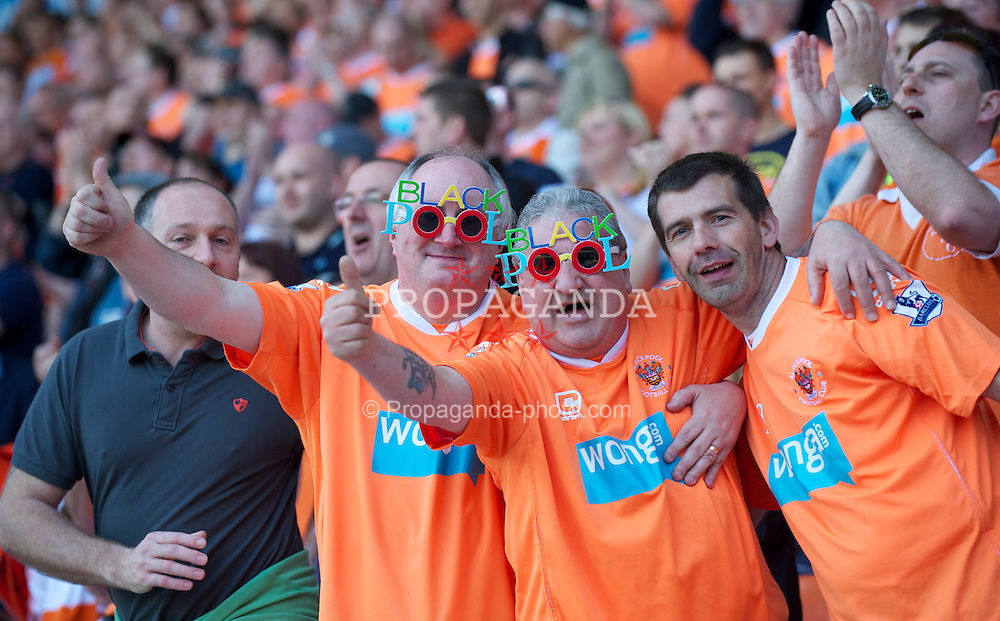 BLACKPOOL, ENGLAND - Sunday, April 10, 2011: Blackpool supporters wearing novely sunglasses before the Premiership match against Arsenal at Bloomfield Road. (Photo by David Rawcliffe/Propaganda)