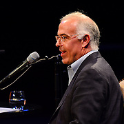 David Brooks speaks during a Writers on a New England Stage show at The Music Hall in Portsmouth, NH