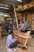 Carpenters making a wooden dhow at Al Darwasa Antiques, a traditional wood carving workshop and shop owned by Jamal Shaheen, a master carpenter, in Muharraq, Bahrain. Shaheen and his 10 carpenters create and restore hand crafted dhows, models, benches, tables, ceiling panels and window frames. Picture by Manuel Cohen