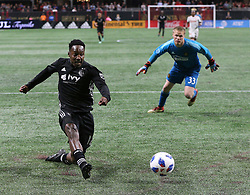 May 9, 2018 - Atlanta, GA, USA - Sporting Kansas City forward Gerso Fernandes scores a goal past Atlanta United goalkeeper Paul Christensen for a 2-0 lead during the second half on Wednesday, May 9, 2018, in Atlanta. Sporting Kansas City won, 2-0. (Credit Image: © Curtis Compton/TNS via ZUMA Wire)