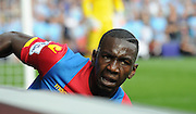 Yannick Bolasie crashes into the advertising boards during the Barclays Premier League match between Crystal Palace and Manchester City at Selhurst Park, London, England on 12 September 2015. Photo by Michael Hulf.