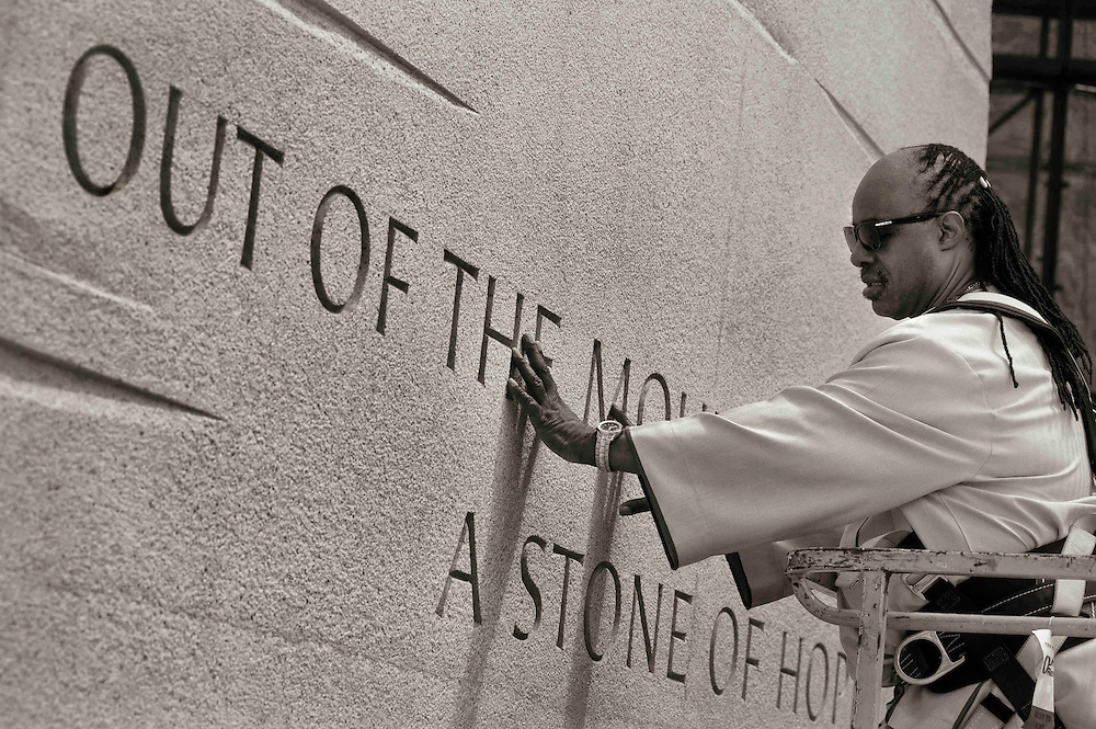 DISTRICT OF COLUMBIA (August 4, 2011) -- World famous American music icon Stevie Wonder feels his hand across the rough outer stone surface of the new Martin Luther King Jr., Memorial. Located across from the Jefferson Memorial and Tidal Basin, it commemorates the life and work of Dr. Martin Luther King, Jr., honoring his global contributions to world peace through non-violent social change. The new memorial looks to perform an official dedication on Sunday, August 28, 2011, which is the 48th anniversary of the March on Washington and Dr. King's historic I Have A Dream speech.  Photo by Johnny Bivera