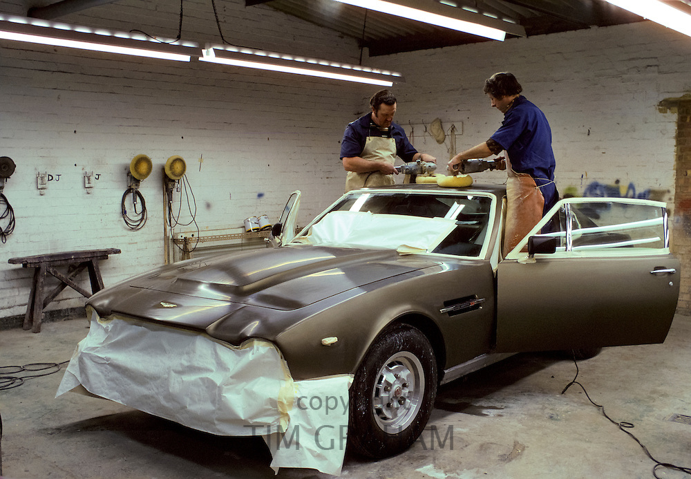 New Aston Martin V8 Vantage sports car polished in bodywork shop at Aston Martin factory, Newport Pagnell, Buckinghamshire, UK