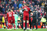 Liverpool Manager Jurgen Klopp gives captain Liverpool midfielder Jordan Henderson (14) a hug at the end of the  Premier League match between Liverpool and Watford at Anfield, Liverpool, England on 14 December 2019.