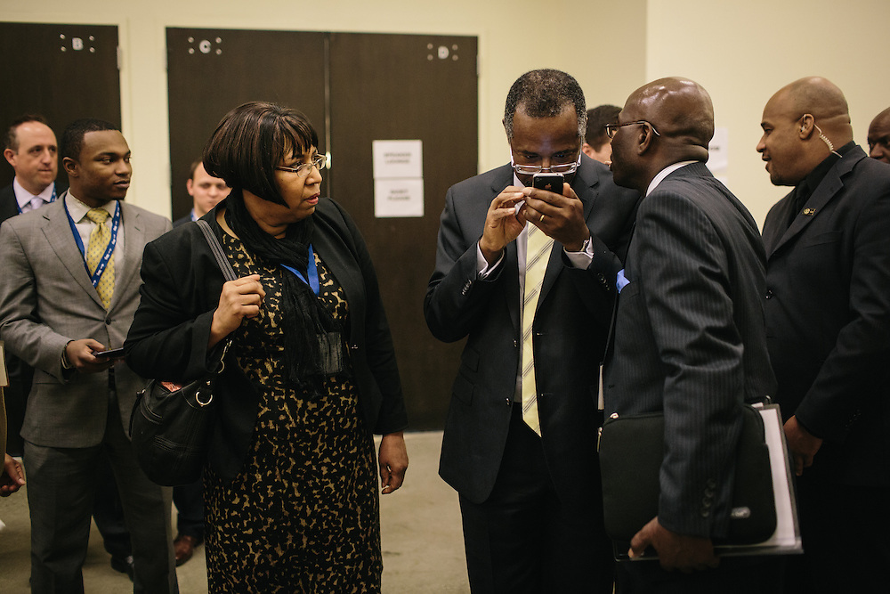 Dr. Ben Carson, center, a retired neurosurgeon, prepares backstage before speaking during the final day of the Conservative Political Action Conference (CPAC) at the Gaylord National Resort & Convention Center in National Harbor, Md.