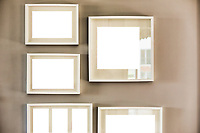 Close up photo of picture frames on the wall in new apartment