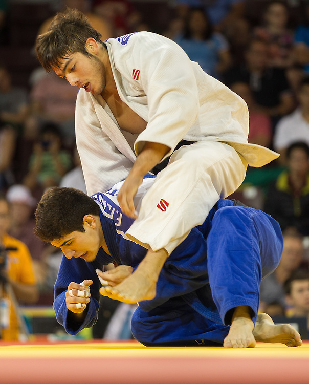 David Tavera (top) of Mexico gets on top of Fernando Ibanez of Ecuador during their 1/8 final contest in the 73kg class at the 2015 Pan American Games in Toronto, Canada, July 12,  2015.  AFP PHOTO/GEOFF ROBINS