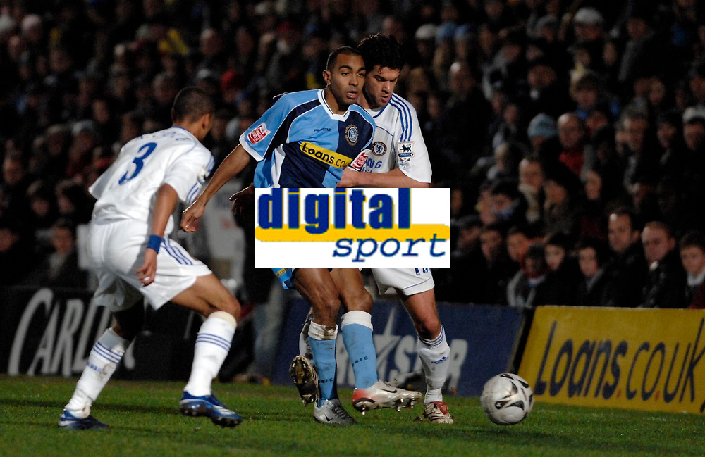 Photo: Richard Lane.<br />Wycombe Wanderers v Chelsea. Carling Cup, Semi Final 1st Leg. 10/01/2007. <br />Chelsea's Michael Ballack and Ashley Cole challenged Wycombe's Kevin Betsy.