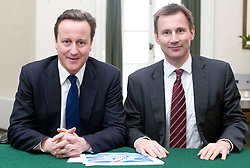 Leader of the Conservative Party David Cameron with Jeremy Hunt.Member of Parliament for South West Surrey in his office in Norman Shaw South, January 18, 2010. Photo By Andrew Parsons / i-Images.