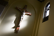 Jesus crucifixtion figure on wall at St. Lawrence's Catholic church in Feltham, London.