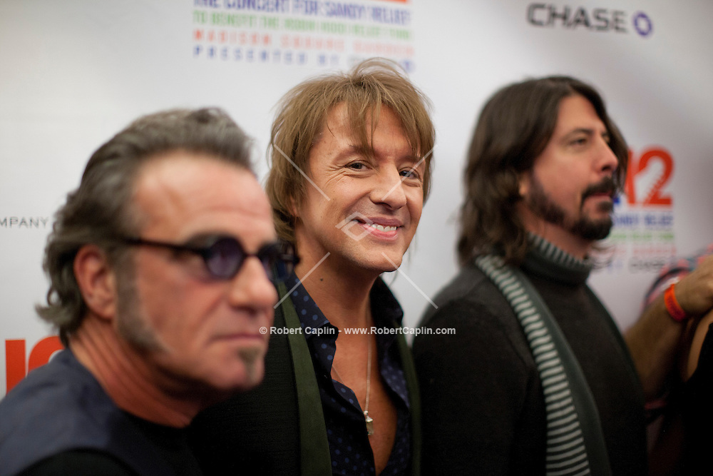"Richie Sambora at a meet-and-greet, ""12-12-12?, a fundraising concert to aid the victims of Hurricane Sandy, will take place on December 12, 2012 at Madison Square Garden. The concert featured The Rolling Stones, Bon Jovi, Eric Clapton, Dave Grohl, Billy Joel, Alicia Keys, Chris Martin, Bruce Springsteen & the E Street Band, Eddie Vedder, Roger Waters, Kanye West, The Who, and Paul McCartney. All the proceeds went go to the Robin Hood Relief Fund. Robin Hood, the largest independent poverty fighting organization in the New York area, will insure that every cent raised will go to non-profit groups that are helping the tens of thousands.of people throughout the tri-state area who have been affected by Hurricane Sandy...Photo © Robert Caplin.."