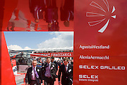 Delegates leave the Italian aerospace and defence Finmeccanica's trade stand at the Farnborough Air Show, UK.