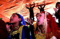 THE ENTERTAINERS..SPECIAL OLYMPICS AFGHANISTAN..KABUL 25 August 2005..Young girls perform a show during  the closing ceremony of the Special Olympics Ganes at Ghazi Stadium...On 23-25 August 2005, Special Olympics Afghanistan held its first national Games at Olympic Stadium in Kabul. ..More than 300 athletes, including 80 female athletes, experienced a taste of happiness and achievement for the first time in their lives. They competed in athletics, bocce and football (soccer). Because of cultural restrictions, males and females competed at separate venues.