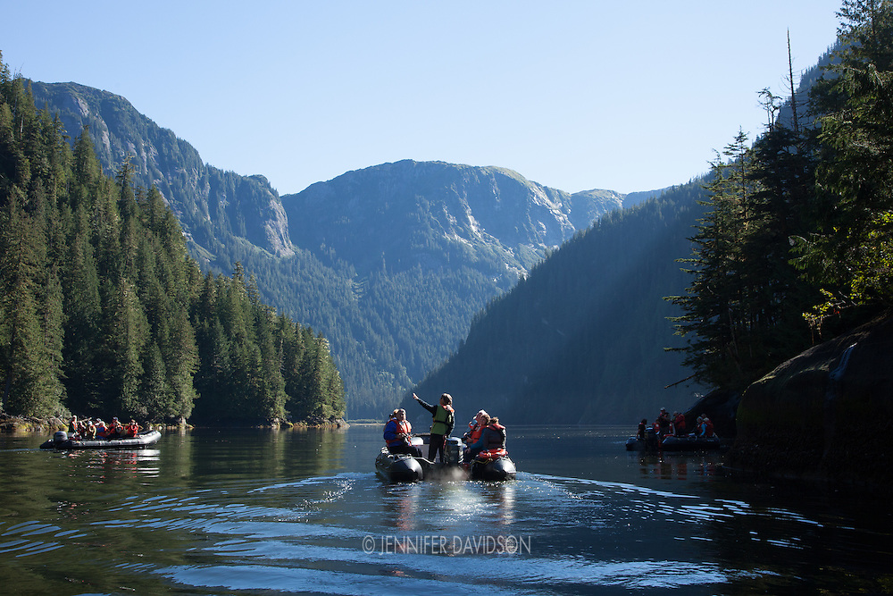 Guests from the National Geographic Sea Lion ride in small inflatable boats at Misty Fjords National Monument, Alaska.