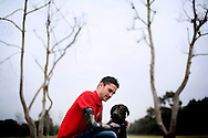 FEB 5 --Brandon Pelletier shares a moment with his dog Skylar at a park near his home in  Chula Vista , CA, on Tuesday, February 5, 2013. <br />  -- This is a story about how the needs of veterans and service members is growing even as the wars end. the focus of the story is on a charity known as Semper Fi Fund which reports that its caseload is growing. this photo would be of one former Marine that that the group has assisted, Brandon Pelletier.  -- Photo by Sandy Huffaker for USA Today<br /> <br /> <br /> Photo by Sandy  Huffaker  Jr., Freelance