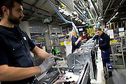 Men and women working in the factory of Whirlpool Corporations. Cassinetta di Biandronno, Varese, Milan, Italy, 30 january 2014. Guido Montani / OneShot