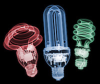 X-ray image of three compact fluorescent lamps (color on black) by Jim Wehtje, specialist in x-ray art and design images.