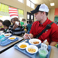 Adam Robison | BUY AT PHOTOS.DJOURNAL.COM<br /> Kaleb Lyons, 5, a student at ECEC, drinks his milk as he has lunch with his new friend, Tupelo Firefighter James Roberts on Friday. The Tupelo Fire Department has started a new program. The firemen on shift go eat lunch at lower elementary schools to give kids a chance to see firemen are their friends.