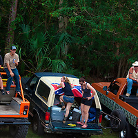 NAPLES, FL -- March 6, 2011 -- Race fans pull up in camouflage and Confedertate flag covered trucks during the Swamp Buggy Races at the Florida Sports Park in Naples, Fla., on Sunday, March 6, 2011.  The races originated in the 1940's by bored hunters and draws thousands of fans three times a year to take in the buggies and jeep compete in the swamp. (Chip Litherland for ESPN the Magazine)