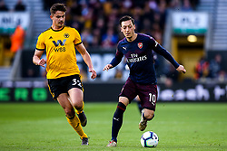 Mesut Ozil of Arsenal takes on Leander Dendoncker of Wolverhampton Wanderers - Mandatory by-line: Robbie Stephenson/JMP - 24/04/2019 - FOOTBALL - Molineux - Wolverhampton, England - Wolverhampton Wanderers v Arsenal - Premier League
