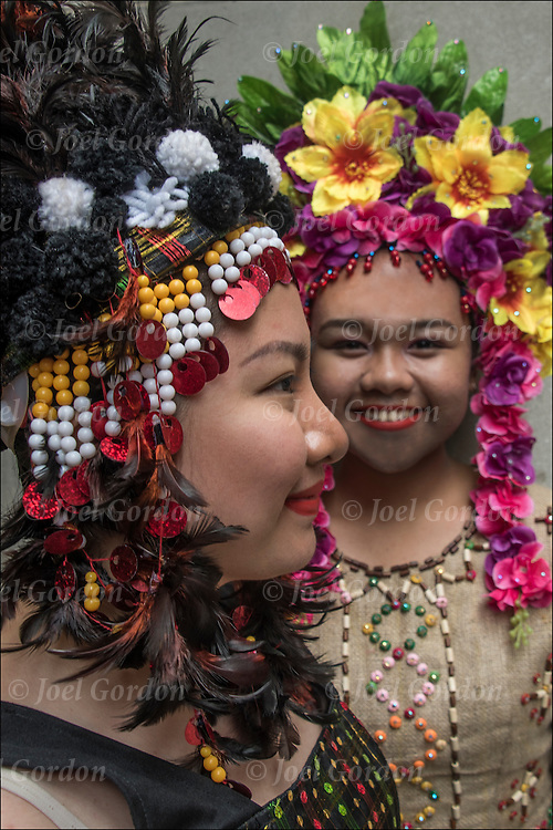 Ethnic Pride for Filipinos in the Philippine Day Day Parade.  Two second generation teenage Filipino American girls are wearing Carnival regalia and headdress.