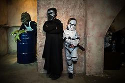 "© Licensed to London News Pictures . 06/12/2015 . Manchester , UK . Hanging about in the cantina . Fans attend Star Wars exhibition "" For the Love of the Force "" at Bowlers Exhibition Centre in Manchester . Photo credit : Joel Goodman/LNP"