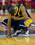 North Carolina A&T senior guard Austin Ewing hides his emotions after their tough lost to Delaware State during the 2008 MEAC Basketball Tournament at the RBC Center in Raleigh, North Carolina.  DSU won 62-60.  March 13, 2008  (Photo by Mark W. Sutton)