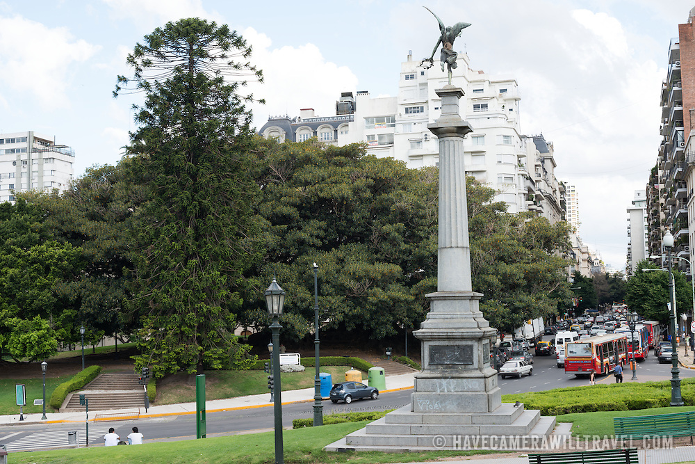 A statue and column in a park in the Recoleta neighborhood in Buenos Aires Argentina