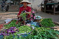 Woman selling vegetables at a farmers market, Myanmar. Exotic places wall art. Fine art photography prints for sale.