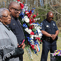 Jo Wilson-Bradley, left, shares her appreciation of everyone who gathered to remember her late brother, Eric 'E.K.' King Wilson, days before the anniversary of his death. Also pictured are Aberdeen Assistant Police Chief Quinell Shumpert and Jimmy Cockerham.