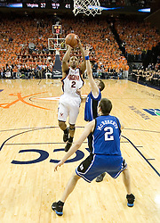 UVA's J.R. Reynolds (2) gets a shot off against Duke.  The University of Virginia Cavaliers beat the #8 ranked Duke University Blue Devils 68-66 in overtime at the John Paul Jones Arena in Charlottesville, VA on February 1, 2007...