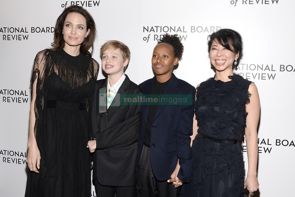 (L-R) Actress Angelina Jolie, son Shiloh Jolie-Pitt, daughter Zahara Jolie-Pitt and Loung Ung attend the The National Board Of Review Annual Awards Gala at Cipriani 42nd Street in New York, NY, on January 9, 2018. (Photo by Anthony Behar/Sipa USA)