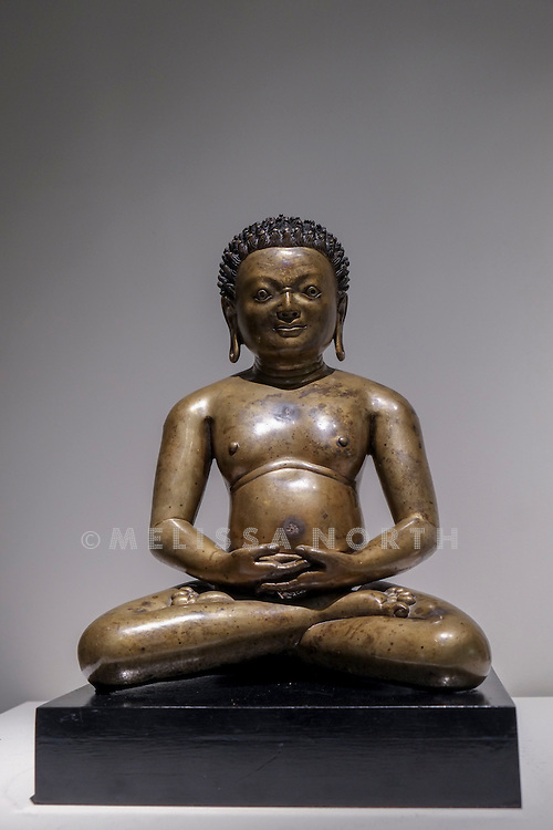 A Rare And Important Bronze Figure of a Mahasiddha from the touring highlights of The Collection of Robert Hatfield Ellsworth, <br /> at Christies in King St, London, UK on Tuesday 16th December 2014. In celebration of this unparalleled collection of Asian Art, Christie&rsquo;s will host a series of auctions and online-only sales during New York Asian Art Week in March 2015. Photo by Melissa North. Ref B5690