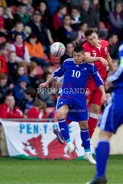 WREXHAM, WALES - Wednesday, February 29, 2012: Wales' Billy Bodin (Swindon Town) and Andorra's Cristopher Pousa (FC Santa Coloma) during the UEFA Under-21 Championship Qualifying Group 3 match at the Racecourse Ground. (Pic by Vegard Grott/Propaganda)