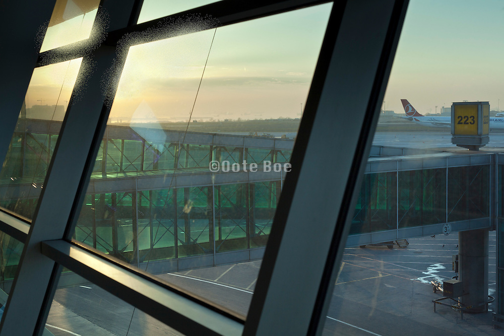 early morning sunrise with airplane terminal at Ataturk airport Istanbul turkey