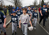 VFW's Christian Collupica and Elk's Ryan Lahey march with their teams into Opechee Park during the Laconia Little League opening day parade Saturday morning.  (Karen Bobotas/for the Laconia Daily Sun)