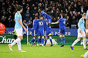 Leicester City midfielder Marc Albrighton (11) is mobbed as his team celebrate the equaliser 1-1 during the quarter final of the EFL Cup match between Leicester City and Manchester City at the King Power Stadium, Leicester, England on 18 December 2018.