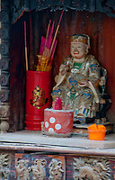 Streetside Budhist shrine with incense in Singapore