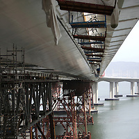 The San Francisco-Oakland Bay Bridge is under construction, and scheduled to open Labor Day 2013. The Self-Anchored Suspension Span (SAS) is the largest bridge of its kind in the world measuring 2,047 feet. This engineering and construction marvel raises the bridge building bar to new heights, as seen in these behind the scenes photos of the new East Span taken on Monday, March 18, 2013. (AP Photo/Alex Menendez)