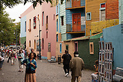 General view of Caminito street, in La Boca neighborhood of Buenos Aires, Argentina.<br /> Caminito is a pedestrian street created in the late 1950s by local painter Benito Quinquela Martín and other artist friends to recreate a version of the old immigrant neighborhood of La Boca, using wood and corrugated zinc painted in bright colors. Today, Caminito and the surrounding areas feature cafes, souvenir shops, tango dancers and other street performances aimed to attract tourists.