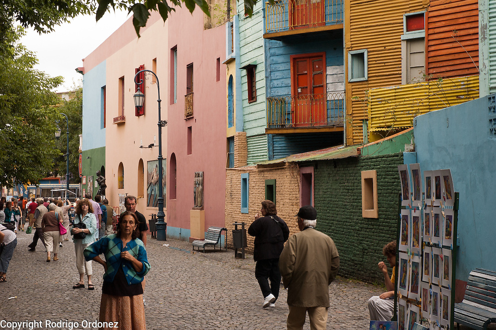 General view of Caminito street, in La Boca neighborhood of Buenos Aires, Argentina.<br /> Caminito is a pedestrian street created in the late 1950s by local painter Benito Quinquela Mart&iacute;n and other artist friends to recreate a version of the old immigrant neighborhood of La Boca, using wood and corrugated zinc painted in bright colors. Today, Caminito and the surrounding areas feature cafes, souvenir shops, tango dancers and other street performances aimed to attract tourists.
