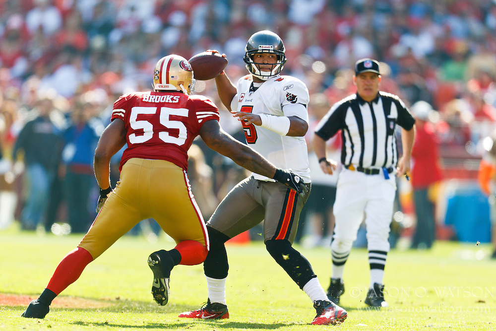 Oct 9, 2011; San Francisco, CA, USA; San Francisco 49ers outside linebacker Ahmad Brooks (55) puts pressure on Tampa Bay Buccaneers quarterback Josh Freeman (5) while passing during the third quarter at Candlestick Park. San Francisco defeated Tampa Bay 48-3. Mandatory Credit: Jason O. Watson-US PRESSWIRE