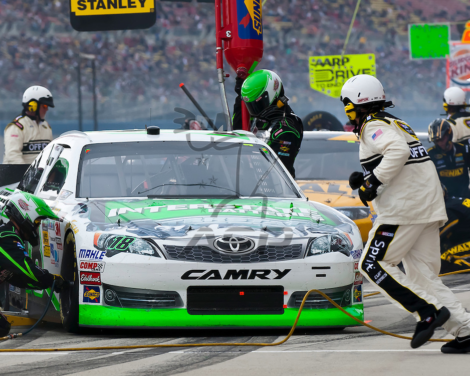 FONTANA, CA - MAR 25, 2012:  Kyle Busch (18) brings his Interstate Batteries Toyota in for service during the Auto Club 400 at the Auto Club Speedway in Fontana, CA.