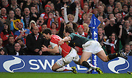 Photo © TOM DWYER / SECONDS LEFT IMAGES 2010 - Rugby Union - Invesco Perpetual Series - Wales v South Africa - 13/11/10 - Wales' George North beats the tackle of South Africa's Francois Steyn to score in the second half - at Millennium Stadium Cardiff Wales UK -  All rights reserved