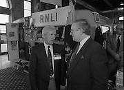 The 1989 Boat Show.   (R89)..1989..10.03.1989..03.10.1989..10th March 1989..Pat the Cope GallagherTD, Minister for the Marine attended the opening of the 1989 Boat Show held at the Point Depot, Dublin. The opening coincided with the minister's birthday...The Minister for the Marine, Pat The Cope Gallagher ,is pictured in conversation with a representative of the RNLI which is a very important organisation in relation to safety at sea.