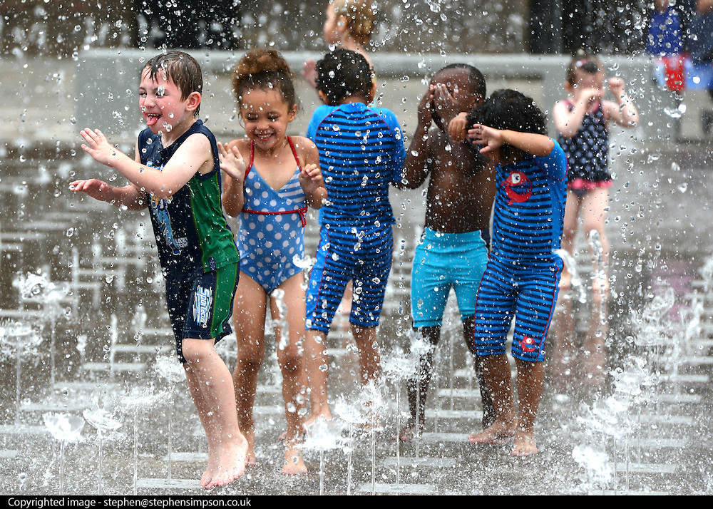 © Licensed to London News Pictures. 19/08/2012. London, UK Children play in the fountains at Granary Square in North London today. 1080 dancing jets of water make up the new fountain in its centre. Today is expected to be the hottest day of the year with temperature peaking at over 32 degrees celsius. Photo credit : Stephen Simpson/LNP
