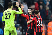 Asmir Begovic (27) of AFC Bournemouth, Adam Smith (15) of AFC Bournemouth and Ryan Fraser (24) of AFC Bournemouth celebrate the 2-1 win over Arsenal at full time during the Premier League match between Bournemouth and Arsenal at the Vitality Stadium, Bournemouth, England on 14 January 2018. Photo by Graham Hunt.