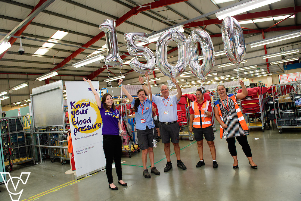 Staff at Spalding Delivery Office celebrate the 15,000 blood pressure readings landmark.  Pictured (holding numbers, from left) Chritselle Sears (from Stroke Association), Liza Rogers, Neil Strickson, Louise Bycraft and Leigh Bedwell.  <br /> <br /> The Stroke Association is the Royal Mail's charity of the year, and as part of the link up between the two organisations the charity has taken 15,000 blood pressure readings of the postal staff.  The landmark was celebrated at the Royal Mail's Spalding delivery office.<br /> <br /> Picture: Chris Vaughan/Chris Vaughan Photography<br /> Date: September 13, 2016